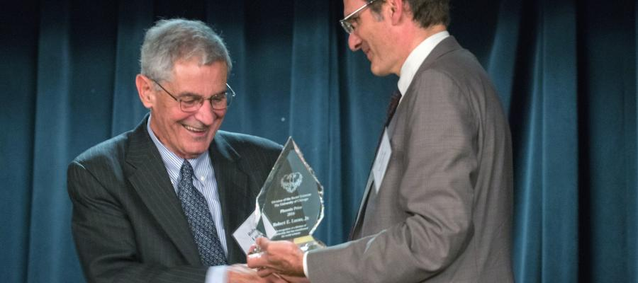 Dean of the Division of the Social Sciences David Nirenberg presents Robert E. Lucas, Jr. with the Phoenix Prize.