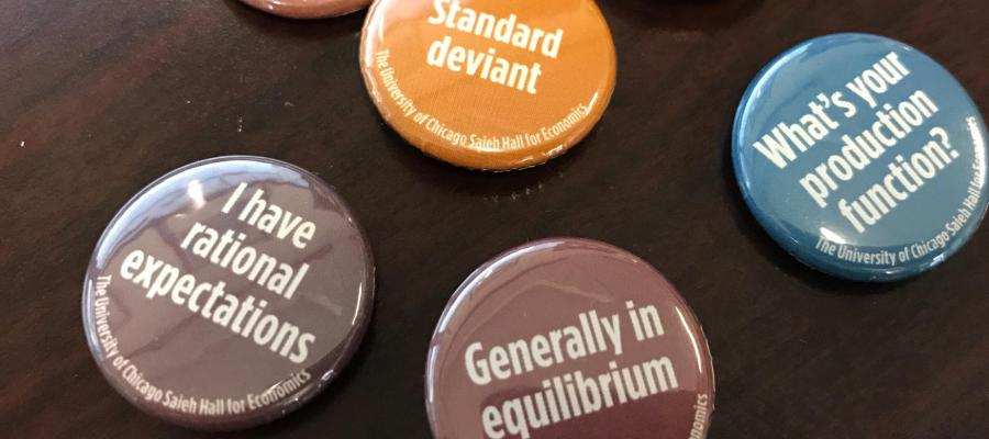 Campaign buttons with social sciences themed puns on them