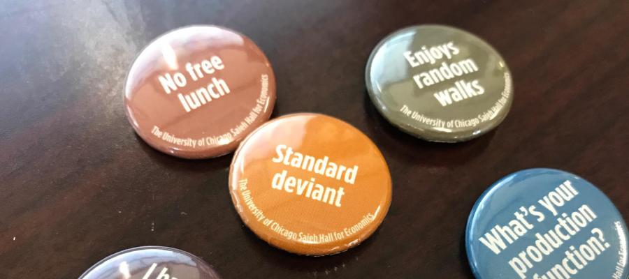 Campaign buttons with math puns on them